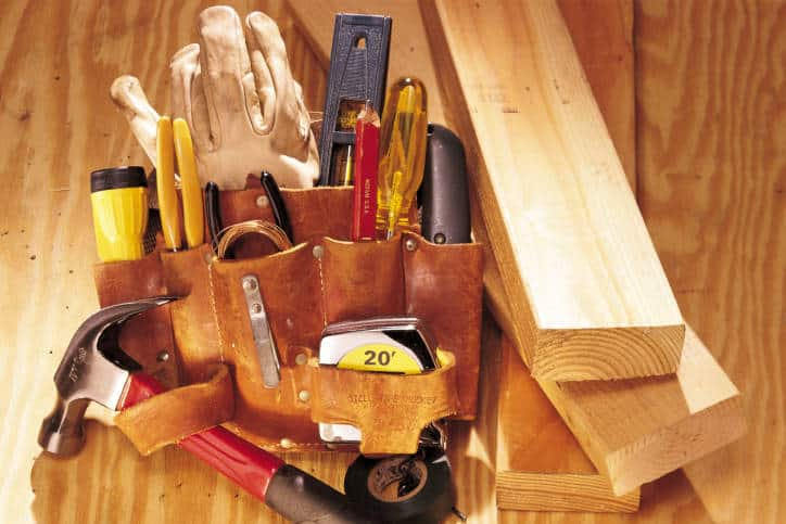 Still life of lumber and tool belt