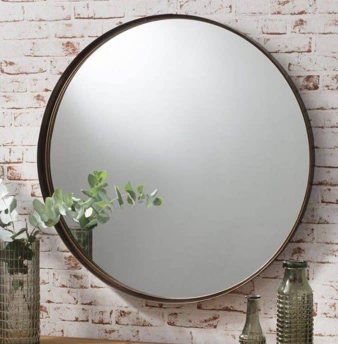 a beautiful round mirror