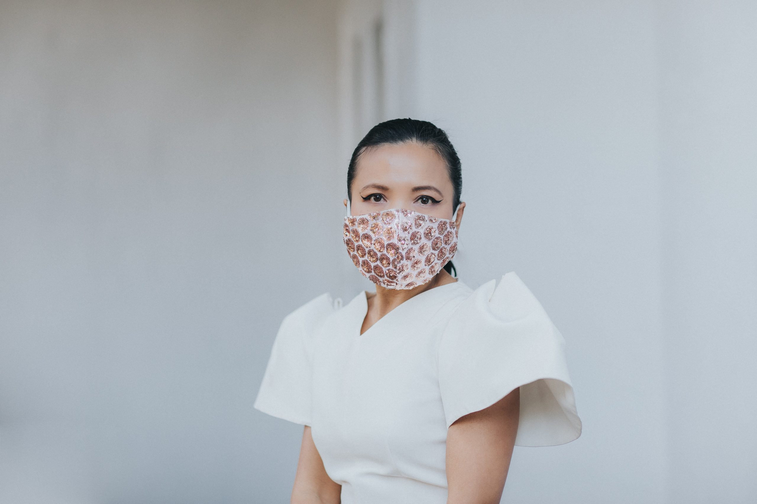 What protection do antimicrobial face coverings offer against COVID-19?
